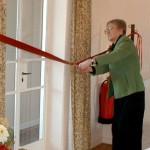 Marie cutting ribbon